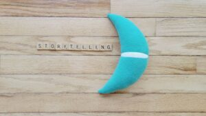 Moonsail North moon and Scrabble pieces spelling Storytelling